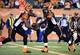 Oct 27, 2013; Cincinnati, OH, USA; Cincinnati Bengals quarterback Josh Johnson (8) hands the ball off to Cincinnati Bengals running back Cedric Peerman (30) during the second half of the game at Paul Brown Stadium. Mandatory Credit: Marc Lebryk-USA TODAY Sports