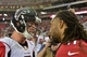 Oct 27, 2013; Phoenix, AZ, USA; Arizona Cardinals wide receiver Larry Fitzgerald (11) and Atlanta Falcons quarterback Matt Ryan (2) talk after the game at University of Phoenix Stadium.  The Cardinals beat the Falcons 27-13.  Mandatory Credit: Matt Kartozian-USA TODAY Sports
