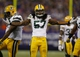 Oct 27, 2013; Minneapolis, MN, USA; Green Bay Packers linebacker Jamari Lattimore (57) celebrates his stop against the Minnesota Vikings in the fourth quarter at Mall of America Field at H.H.H. Metrodome. The Packers win 44-31. Mandatory Credit: Bruce Kluckhohn-USA TODAY Sports