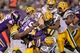 Oct 27, 2013; Minneapolis, MN, USA; Minnesota Vikings running back Adrian Peterson (28) is stopped by the Green Bay Packers defense during the fourth quarter at Mall of America Field at H.H.H. Metrodome. The Packers defeated the Vikings 44-31. Mandatory Credit: Brace Hemmelgarn-USA TODAY Sports