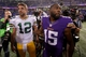 Oct 27, 2013; Minneapolis, MN, USA; Minnesota Vikings wide receiver Greg Jennings (15) talks with Green Bay Packers quarterback Aaron Rodgers (12) following the game at Mall of America Field at H.H.H. Metrodome. The Packers defeated the Vikings 44-31. Mandatory Credit: Brace Hemmelgarn-USA TODAY Sports