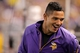 Oct 27, 2013; Minneapolis, MN, USA; Minnesota Vikings quarterback Josh Freeman (12) laughs during the fourth quarter against the Green Bay Packers at Mall of America Field at H.H.H. Metrodome. The Packers defeated the Vikings 44-31. Mandatory Credit: Brace Hemmelgarn-USA TODAY Sports