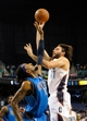 Oct 19, 2013; Greensboro, NC, USA; Charlotte Bobcats forward Josh McRoberts (11) drives to the basket as he is defended by Dallas Mavericks forward Renaldo Balkman (13) during the game at the Greensboro Coliseum. Mavericks win 89-83. Mandatory Credit: Sam Sharpe-USA TODAY Sports