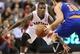 Oct 11, 2013; Toronto, Ontario, CAN; Toronto Raptors guard Dwight Buycks (13) defends against New York Knicks point guard Beno Udrih (18) at Air Canada Centre. The Raptors beat the Knicks 100-91. Mandatory Credit: Tom Szczerbowski-USA TODAY Sports