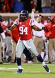 Oct 19, 2013; Oxford, MS, USA; Mississippi Rebels defensive tackle Issac Gross (94) celebrates after a play during the game against the LSU Tigers at Vaught-Hemingway Stadium. Mississippi Rebels defeat the LSU Tigers 27-24.  Mandatory Credit: Spruce Derden-USA TODAY Sports