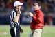 Oct 19, 2013; Oxford, MS, USA; Mississippi Rebels head coach Hugh Freeze talks with an official during the game against the LSU Tigers at Vaught-Hemingway Stadium. Mississippi Rebels defeat the LSU Tigers 27-24.  Mandatory Credit: Spruce Derden-USA TODAY Sports