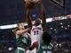 Oct 30, 2013; Toronto, Ontario, CAN; Toronto Raptors forward Rudy Gay (22) dunks in between Boston Celtics forward Kelly Olynyk (41) and forward Gerald Wallace (45) during the first half at the Air Canada Centre. Mandatory Credit: John E. Sokolowski-USA TODAY Sports