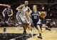 Oct 30, 2013; San Antonio, TX, USA; Memphis Grizzlies guard Nick Calathes (12) drives to the basket as San Antonio Spurs forward Boris Diaw (33) defends during the first half at AT&T Center. Mandatory Credit: Soobum Im-USA TODAY Sports