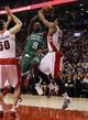 Oct 30, 2013; Toronto, Ontario, CAN; Boston Celtics forward Jeff Green (8) battles Toronto Raptors guard DeMar DeRozan (10) at the Air Canada Centre. Toronto defeated Boston 93-87. Mandatory Credit: John E. Sokolowski-USA TODAY Sports