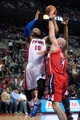 Oct 30, 2013; Auburn Hills, MI, USA; Washington Wizards center Marcin Gortat (4) attempts to block Detroit Pistons center Greg Monroe (10) during the fourth quarter at The Palace of Auburn Hills. Pistons won 113-102. Mandatory Credit: Tim Fuller-USA TODAY Sports
