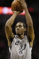 Oct 30, 2013; San Antonio, TX, USA; San Antonio Spurs forward Kawhi Leonard (2) shoots a free throw during the second half against the Memphis Grizzlies at AT&T Center. The Spurs won 101-94. Mandatory Credit: Soobum Im-USA TODAY Sports
