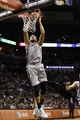 Oct 30, 2013; San Antonio, TX, USA; San Antonio Spurs forward Marco Belinelli (3) dunks during the second half against the Memphis Grizzlies at AT&T Center. The Spurs won 101-94. Mandatory Credit: Soobum Im-USA TODAY Sports
