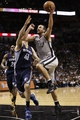 Oct 30, 2013; San Antonio, TX, USA; San Antonio Spurs guard Manu Ginobili (20) drives to the basket as Memphis Grizzlies center Kosta Koufos (41) defends during the second half at AT&T Center. The Spurs won 101-94. Mandatory Credit: Soobum Im-USA TODAY Sports