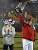 Oct 30, 2013; Boston, MA, USA; Boston Red Sox manager John Farrell hoists the World Series championship trophy after game six of the MLB baseball World Series against the St. Louis Cardinals at Fenway Park. The Red Sox won 6-1 to win the series four games to two. Mandatory Credit: Robert Deutsch-USA TODAY Sports