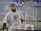 Oct 30, 2013; Boston, MA, USA; Boston Red Sox second baseman Dustin Pedroia stands next to the World Series championship trophy after game six of the MLB baseball World Series against the St. Louis Cardinals at Fenway Park. The Red Sox won 6-1 to win the series four games to two. Mandatory Credit: Robert Deutsch-USA TODAY Sports