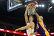 Oct 30, 2013; Oakland, CA, USA; Golden State Warriors center Ognjen Kuzmic (1) scores a basket against Los Angeles Lakers center Robert Sacre (50) during the fourth quarter at Oracle Arena. The Golden State Warriors defeated the Los Angeles Lakers 125-94. Mandatory Credit: Kelley L Cox-USA TODAY Sports