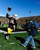 Oct 26, 2013; Iowa City, IA, USA; Iowa Hawkeyes quarterback Jake Rudock (15) runs off the field after defeating the Northwestern Wildcats 17-10 in overtime at Kinnick Stadium. Mandatory Credit: Byron Hetzler-USA TODAY Sports