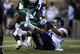 Oct 31, 2013; Denton, TX, USA; North Texas Mean Green defensive back Marcus Trice (8) intercepts a pass in front of Rice Owls wide receiver Derek Brown (8) to seal the win at Apogee Stadium. The Mean Green defeated the Owls 28-16. Mandatory Credit: Jerome Miron-USA TODAY Sports