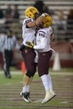 Oct 31, 2013; Pullman, WA, USA; Arizona State Sun Devils running back D.J. Foster (8) celebrates with center Kody Koebensky (67) after scoring on a 23-yard touchdown pass against the Washington State Cougars in the third quarter at Martin Stadium. Arizona State defeated Washington State 55-21. Mandatory Credit: Kirby Lee-USA TODAY Sports