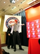 Nov 1, 2013; Washington, DC, USA; Washington Nationals general manager Mike Rizzo (left) helps manager Matt Williams (right) try on his jersey during the press conference at Nationals Park. Mandatory Credit: Evan Habeeb-USA TODAY Sports