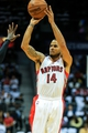 Nov 1, 2013; Atlanta, GA, USA; Toronto Raptors point guard D.J. Augustin (14) shoots a basket in the first half against the Atlanta Hawks at Philips Arena. Mandatory Credit: Daniel Shirey-USA TODAY Sports