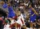 Nov 1, 2013; Washington, DC, USA; Philadelphia 76ers point guard Tony Wroten (8) leaps to pass the ball over Washington Wizards shooting guard Bradley Beal (3) in the fourth quarter at Verizon Center. The 76ers won 109-102. Mandatory Credit: Geoff Burke-USA TODAY Sports