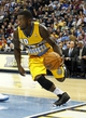 Nov 1, 2013; Denver, CO, USA; Denver Nuggets point guard Nate Robinson (10) controls the ball in the second quarter against the Portland Trail Blazers at the Pepsi Center. Mandatory Credit: Isaiah J. Downing-USA TODAY Sports