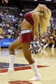 Nov 1, 2013; Washington, DC, USA; A Washington Wizards Girl dances on the court during a stoppage in play against the Philadelphia 76ers at Verizon Center. The 76ers won 109-102. Mandatory Credit: Geoff Burke-USA TODAY Sports