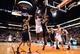Nov 1, 2013; Phoenix, AZ, USA; Phoenix Suns forward Channing Frye (8) puts up a shot against the Utah Jazz forward Derrick Favors (15) in the first half at US Airways Center. Mandatory Credit: Jennifer Stewart-USA TODAY Sports