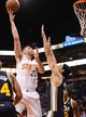 Nov 1, 2013; Phoenix, AZ, USA; Phoenix Suns forward Miles Plumlee (22) lays up the ball against the Utah Jazz center Enes Kanter (0) in the first half at US Airways Center. Mandatory Credit: Jennifer Stewart-USA TODAY Sports
