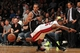 Nov 1, 2013; Brooklyn, NY, USA; Brooklyn Nets point guard Shaun Livingston (14) and Miami Heat point guard Mario Chalmers (15) chase a loose ball during the fourth quarter of a game at Barclays Center. Mandatory Credit: Brad Penner-USA TODAY Sports