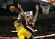 Nov 1, 2013; Denver, CO, USA; Portland Trail Blazers center Robin Lopez (42) knocks the ball away from Denver Nuggets power forward J.J. Hickson (7) in the third quarter at the Pepsi Center. The Trail Blazers won 113-98. Mandatory Credit: Isaiah J. Downing-USA TODAY Sports