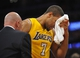 November 1, 2013; Los Angeles, CA, USA; Los Angeles Lakers shooting guard Xavier Henry (7) is treated for an injury by trainer Gary Vitti during a stoppage in play in the first half at Staples Center. Mandatory Credit: Gary A. Vasquez-USA TODAY Sports