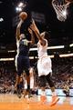 Nov 1, 2013; Phoenix, AZ, USA; Utah Jazz forward Derrick Favors (15) puts up a shot against the Phoenix Suns forward Markieff Morris (11) in the second half at US Airways Center.  The Suns defeated the Jazz 87-84. Mandatory Credit: Jennifer Stewart-USA TODAY Sports