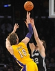 November 1, 2013; Los Angeles, CA, USA; Los Angeles Lakers power forward Pau Gasol (16) is fouled on a scoring attempt against the San Antonio Spurs during the second half at Staples Center. Mandatory Credit: Gary A. Vasquez-USA TODAY Sports
