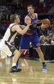 Oct 23, 2013; Green Bay, WI, USA; New York Knicks guard Beno Udrih (7) looks to pass as Milwaukee Bucks point guard Nate Wolters defends at the Resch Center in Green Bay. The Bucks defeated the Knicks 105-95. Mandatory Credit: Mary Langenfeld-USA TODAY Sports