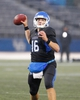 Oct 19, 2013; Buffalo, NY, USA; Buffalo Bulls quarterback Joe Licata (16) throws the ball against the Massachusetts Minutemen at University of Buffalo Stadium. Buffalo beats Massachusetts 32 to 3.  Mandatory Credit: Timothy T. Ludwig-USA TODAY Sports