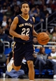 Oct 25, 2013; Orlando, FL, USA; New Orleans Pelicans point guard Brian Roberts (22) dribbles the ball against the Orlando Magic during the second half at Amway Center. New Orleans Pelicans defeated the Orlando Magic 101-82.  Mandatory Credit: Kim Klement-USA TODAY Sports