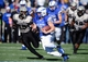 Nov 2, 2013; Colorado Springs, CO, USA; Army Black Knights defensive end Robert Kough (99) chases down  Air Force Falcons quarterback Nate Romine (6) in the first quarter at Falcon Stadium. Mandatory Credit: Ron Chenoy-USA TODAY Sports