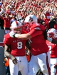 Nov 2, 2013; Raleigh, NC, USA; North Carolina State Wolfpack quarterback Brandon Mitchell (8) is congratulated by teammate Alex Barr (71) after a first quarter touchdown against the North Carolina Tar Heels at Carter Finley Stadium. Mandatory Credit: Rob Kinnan-USA TODAY Sports