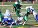 Nov 2, 2013; Birmingham, AL, USA;  UAB Blazers running back Jordan Howard (7) hurdles Middle Tennessee State Blue Raiders defensive end Steven Rhodes (49) at Legion Field. Mandatory Credit: Marvin Gentry-USA TODAY Sports