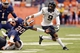 Nov 2, 2013; Syracuse, NY, USA; Wake Forest Demon Deacons cornerback Kevin Johnson (9) grabs the helmet of Syracuse Orange wide receiver Brisly Estime (20) on a tackle during the second quarter of a game at the Carrier Dome. Mandatory Credit: Mark Konezny-USA TODAY Sports