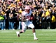 Nov 2, 2013; Iowa City, IA, USA;  Wisconsin Badgers running back Melvin Gordon (25) carries the football against the Iowa Hawkeyes at Kinnick Stadium.  Wisconsin beat Iowa 28-9.  Mandatory Credit: Reese Strickland-USA TODAY Sports