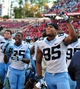 Nov 2, 2013; Raleigh, NC, USA;  North Carolina Tar Heels tight end Eric Ebron (85) and safety Damien Washington (35) celebrate a victory against the North Carolina State Wolfpack at Carter Finley Stadium.  North Carolina beat North Carolina State 27-19.  Mandatory Credit: Rob Kinnan-USA TODAY Sports