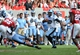 Nov 2, 2013; Raleigh, NC, USA;  North Carolina Tar Heels quarterback Marquise Williams (12) runs the ball during the second half against the North Carolina State Wolfpack at Carter Finley Stadium.  North Carolina beat North Carolina State 27-19.  Mandatory Credit: Rob Kinnan-USA TODAY Sports
