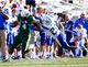 Nov 2, 2013; Birmingham, AL, USA;  UAB Blazers quarterback Jonathan Perry (14) pushes away Middle Tennessee State Blue Raiders safety Kevin Byard (20) at Legion Field. The Blue Raiders defeat the Blazers 24-21. Mandatory Credit: Marvin Gentry-USA TODAY Sports