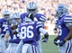 Nov 2, 2013; Manhattan, KS, USA; Kansas State Wildcats wide receiver Tramaine Thompson (86) is congratulated by teammates after scoring a touchdown against the Iowa State Cyclones during the second half at Bill Snyder Family Stadium. The Wildcats defeat the Cyclones 41-7. Mandatory Credit: Jasen Vinlove-USA TODAY Sports