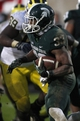 Nov 2, 2013; East Lansing, MI, USA; Michigan State Spartans running back Jeremy Langford (33) runs the ball during the fourth quarter against the Michigan Wolverines at Spartan Stadium. Spartans beat the Wolverines 29-6. Mandatory Credit: Raj Mehta-USA TODAY Sports
