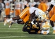 Nov 2, 2013; Columbia, MO, USA; Missouri Tigers running back Marcus Murphy (6) is tackled by Tennessee Volunteers defensive back Malik Foreman (22) and defensive back Michael F. Williams (7) during the first half of the game at Faurot Field. Mandatory Credit: Denny Medley-USA TODAY Sports