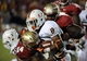 Nov 2, 2013; Tallahassee, FL, USA; Miami Hurricanes running back Duke Johnson (8) is tackled by Florida State Seminoles linebacker Terrance Smith (24) and defensive tackle Timmy Jernigan (8) during the first half at Doak Campbell Stadium. Mandatory Credit: Melina Vastola-USA TODAY Sports